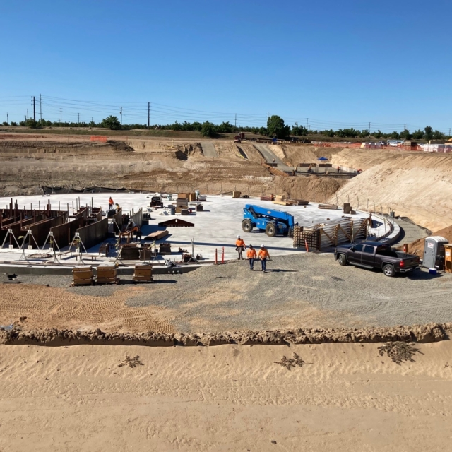 Pre-manufactured steel wall forms are being placed at the water storage tank.