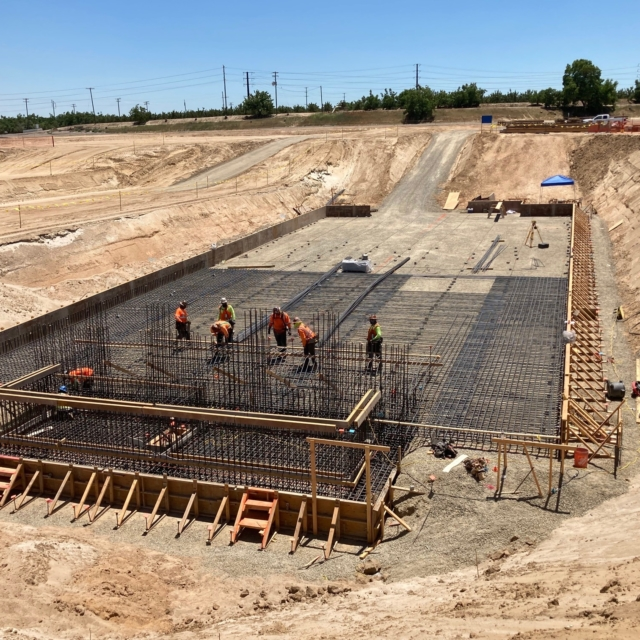 The contractor is placing reinforcing bar and wall forms at the Backwash Equalization Basin.