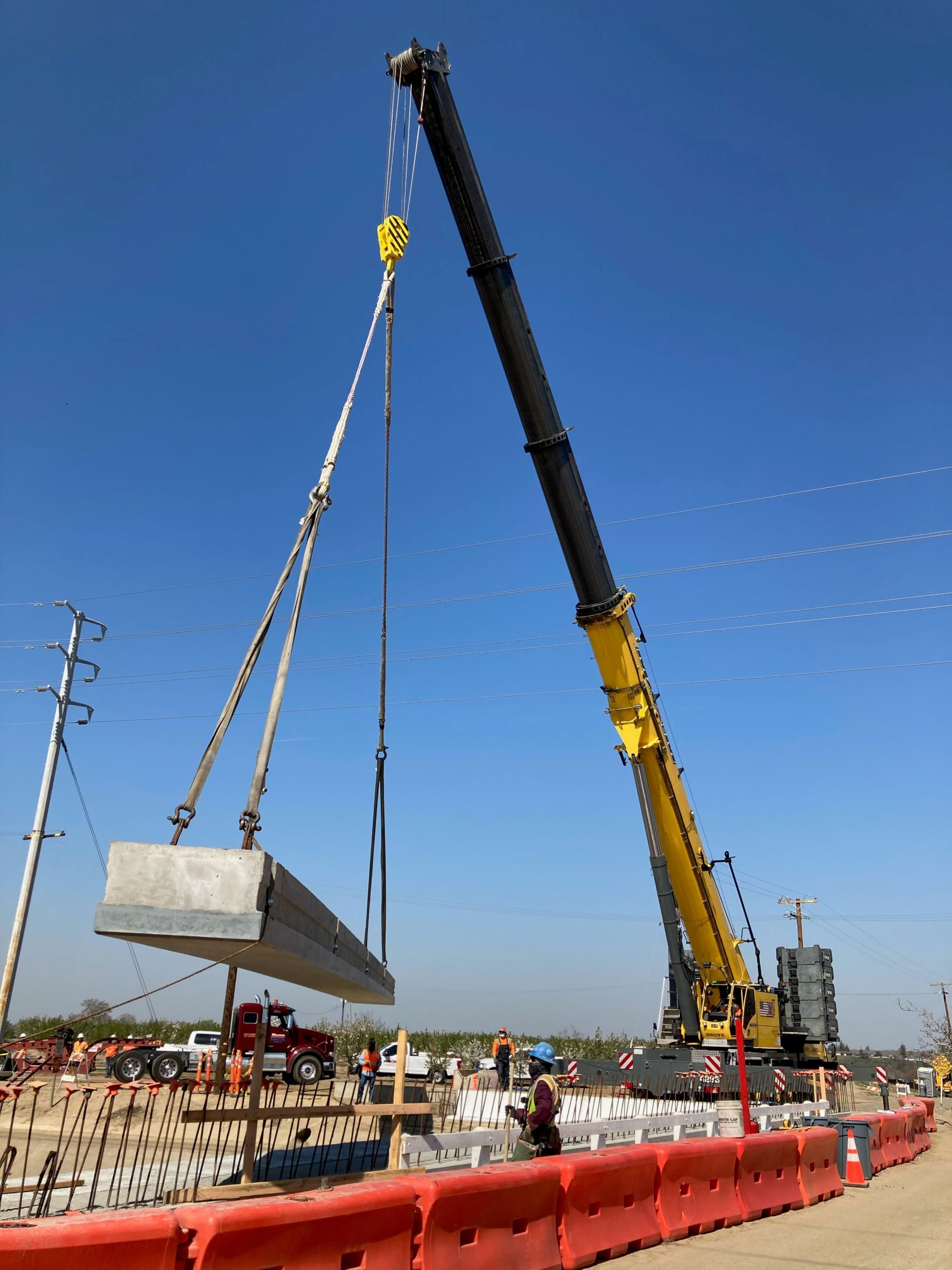 Crane installing girder at the Aldrich Road Replacement Project