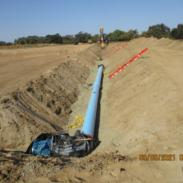 """The contractor continues to excavate and install 12"""" unthickened sludge lines for the drying beds."""