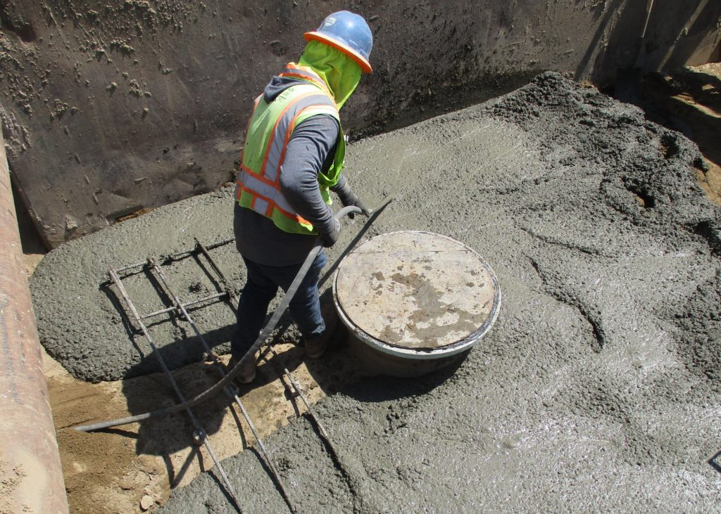The contractor is placing concrete for a maintenance hole at the corner of Service and Berkeley.