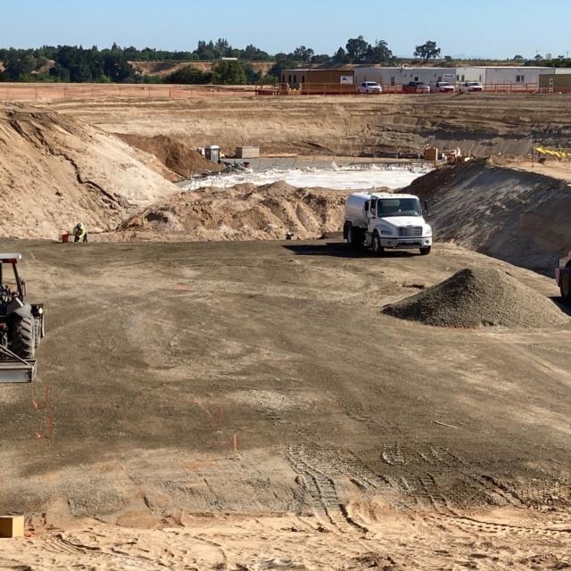 Placing and compacting base rock at the Backwash Equalization Basin
