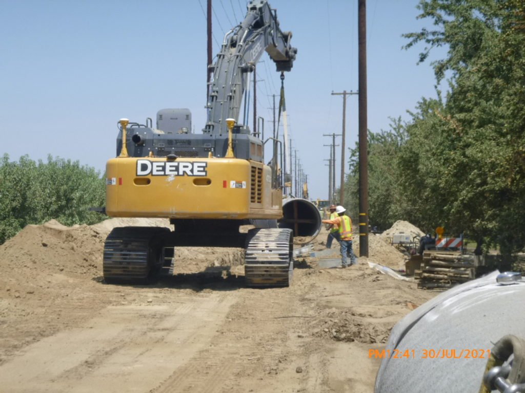 """The contractor laying 42"""" steel pipe down Aldrich Rd towards Fox Rd"""