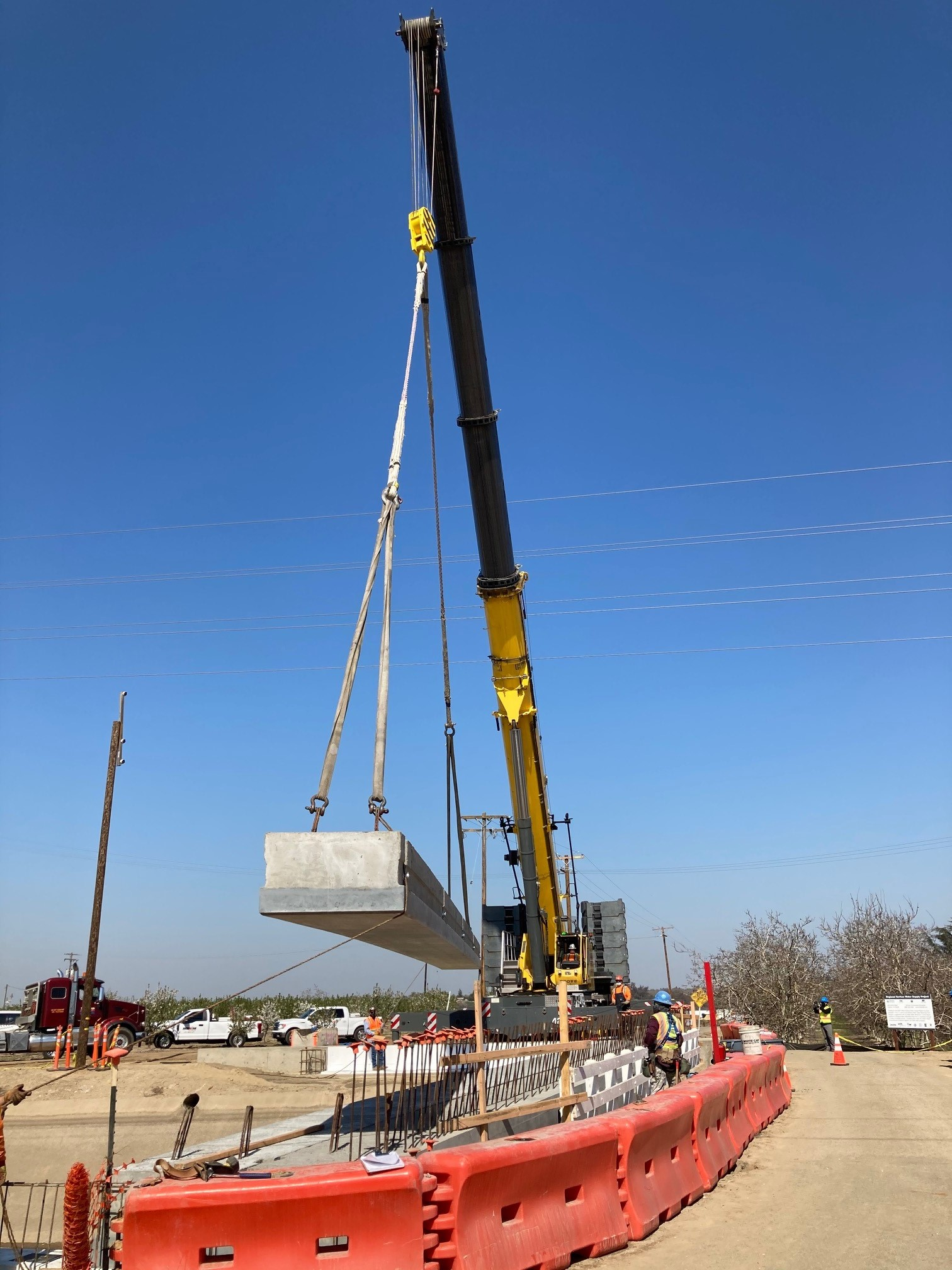 Crane placing a girder at the Aldrich Road Bridge Replacement Project