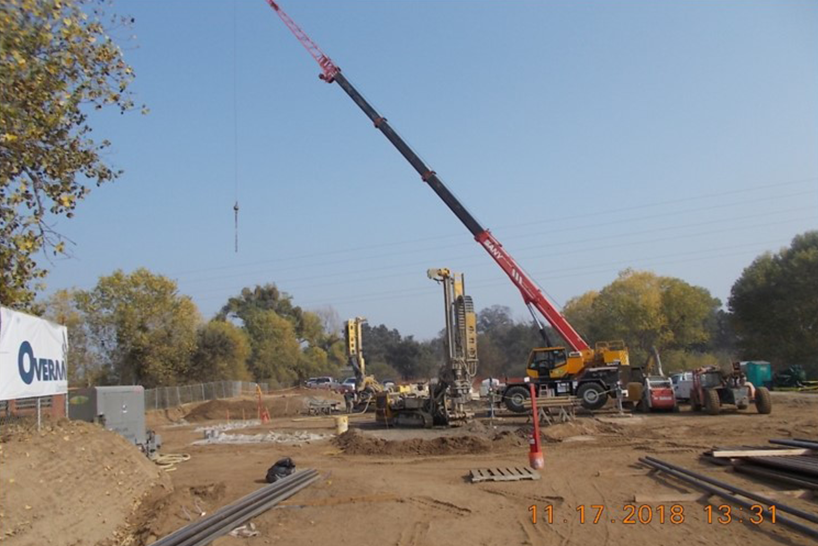 Freeze Pipe being Installed in Borehole by Crane